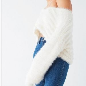 Urban Outfitters》cropped fuzzy bell sleeve sweater